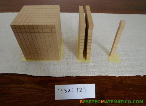 Tras repartir todos los bloques Base 10 el resultado de la división es 12