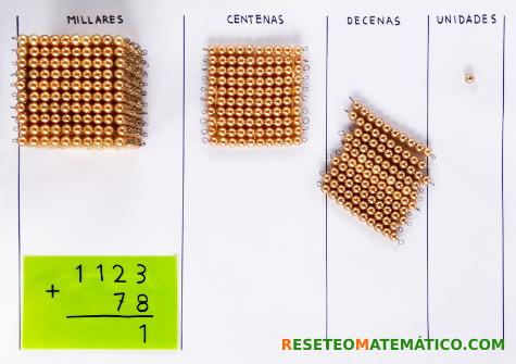 suma con llevada con perlas doradas Montessori. Paso 4