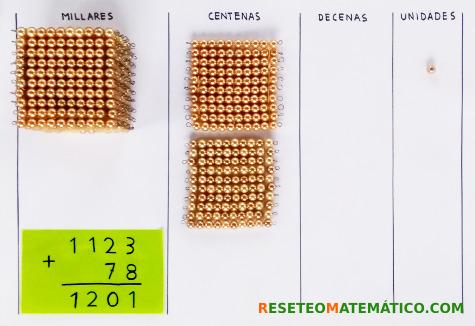 suma con llevada con perlas doradas Montessori. Paso 8